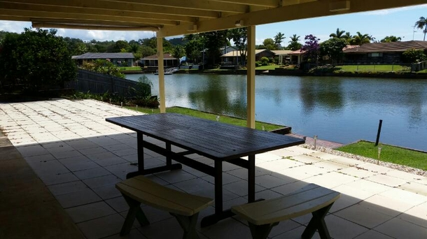 Home exchange in,Australia,Currumbin Waters, Gold Coast,water view from back year and table with 8 chairs