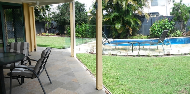 Home exchange in,Australia,HOPE ISLAND,Back patio overlooks swimming pool