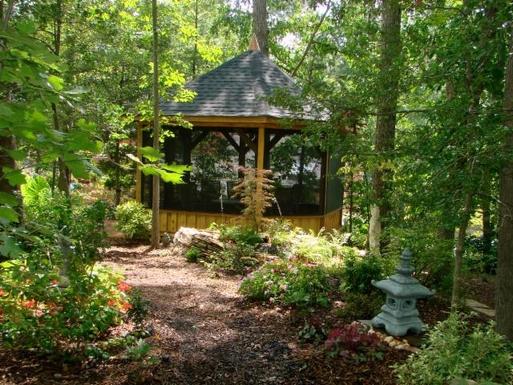 Gazebo in woodlands behind house