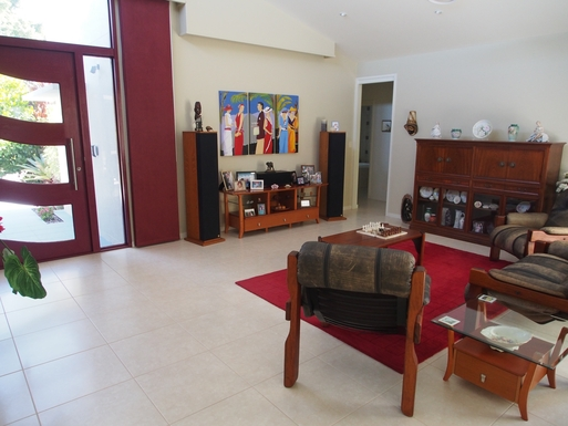 Home exchange in,Australia,Banksia Beach, Bribie Island,Front door entry, and lounge area to watch movies