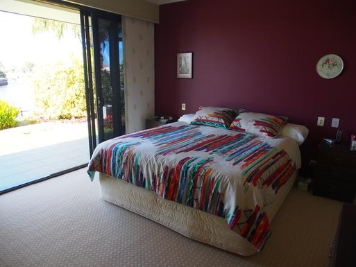 Home exchange in,Australia,Banksia Beach, Bribie Island,Bedroom with kingsize bed overlooking canal.