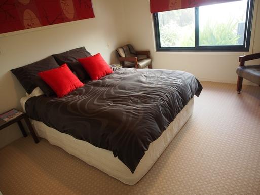 Home exchange in,Australia,Banksia Beach, Bribie Island,Bedroom with queensize bed overlooks courtyard