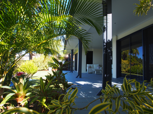 Home exchange in,Australia,Banksia Beach, Bribie Island,View across back of house - canal on left