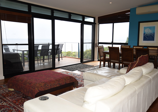 Home exchange in,Australia,Coolum Beach,Upstairs lounge, dining and deck area - 1st level