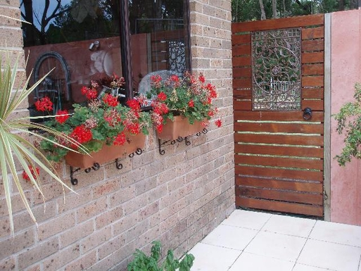 Home exchange in,Australia,Newcastle, 40k, N,Exit to Backyard from Courtyard