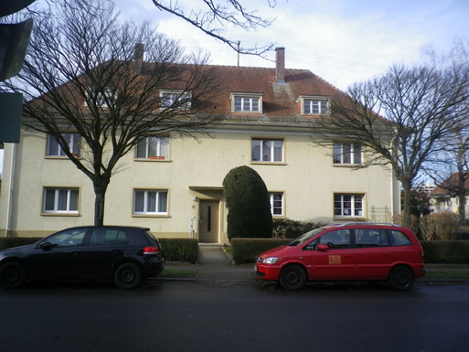 Our house with our red Opel Zafira, a 5-7 seater