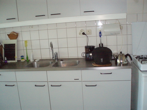 The kitchen is spacious with several storerooms an