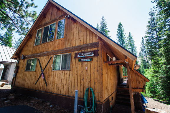 A knotty pine cabin both inside and outside.