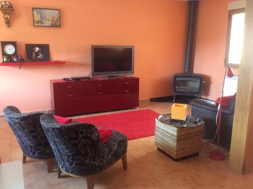 BoligBytte til,Spain,Montejo de la Sierra,Front room with flat screen t.v. and wood burner