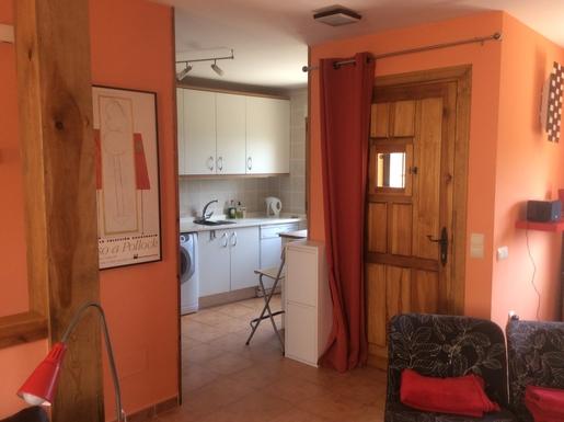 BoligBytte til,Spain,Montejo de la Sierra,Front door leading into front room and kitchen