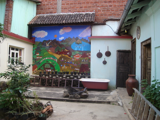 BoligBytte til,Mexico,Uruapan,the back patio with mural of Michoacan scenes