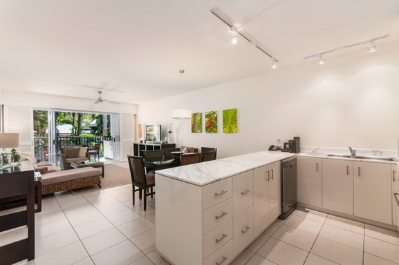 Home exchange in,Australia,PALM COVE,Kitchen, dining and balcony