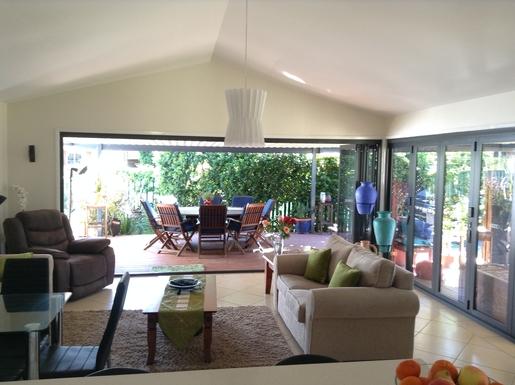Home exchange in,Australia,Cornubia,Living Area with Netflix TV