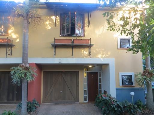 Home exchange in,Australia,Sunshine Beach,street view: garage, entry door, kitchen window