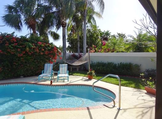 Backyard pool, hammock, lounges, gardens