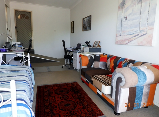 Home exchange in,Australia,Margate,Recreation room with single bed.
