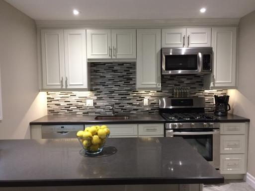 Gournmet kitchen with Stainless steel appliances.