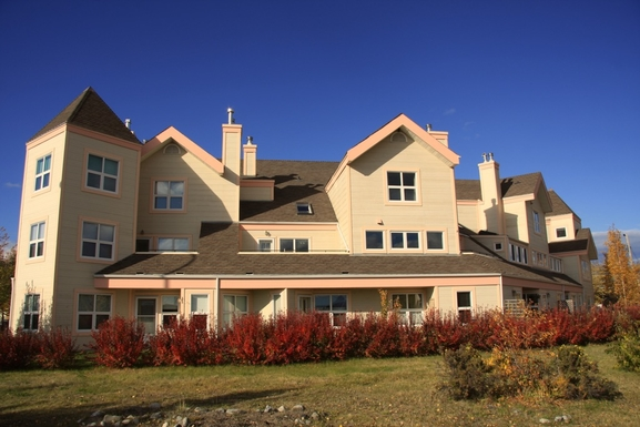 Home exchange in,Canada,Whitehorse,Condo - top two floors under the peak right centre