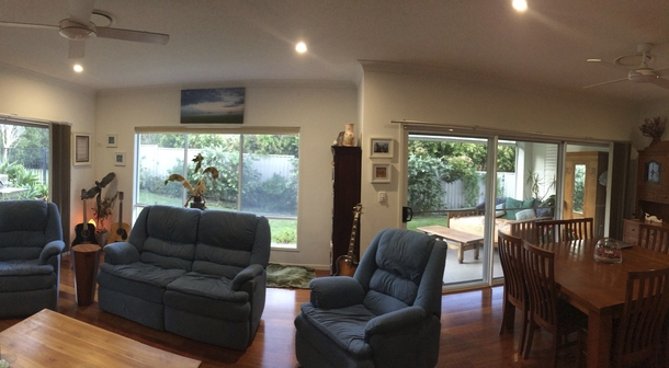 Home exchange in,Australia,POTTSVILLE,Lounge/dining room. - view to daybed.