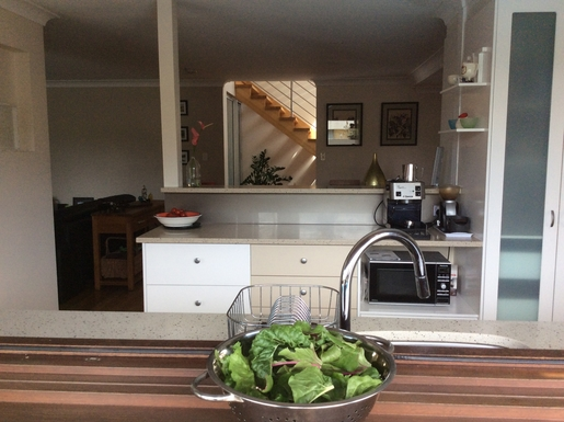 Home exchange in,Australia,MERMAID BEACH,Looking into the kitchen from the outdoor bench