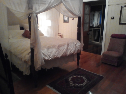 Home exchange in,Australia,Tamborine Mountain,Bedroom 1 with walk-in-robe upstairs