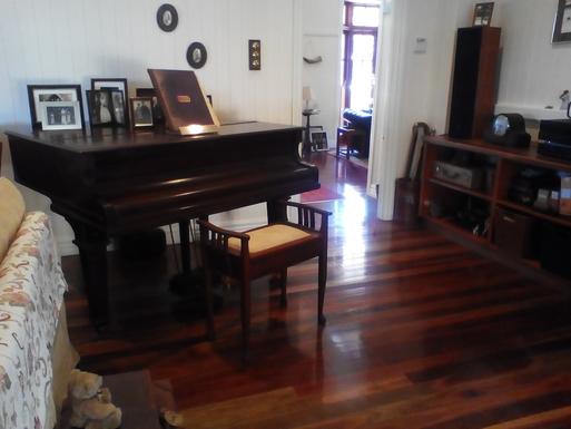 Home exchange in,Australia,Tamborine Mountain,Piano looking towards front door