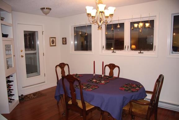 Home exchange in,Canada,Whitehorse,Dining Room - door to balcony