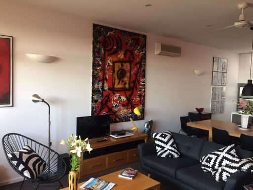 Home exchange in,Australia,FITZROY,Lounge and dining room orverlooking the balcony.