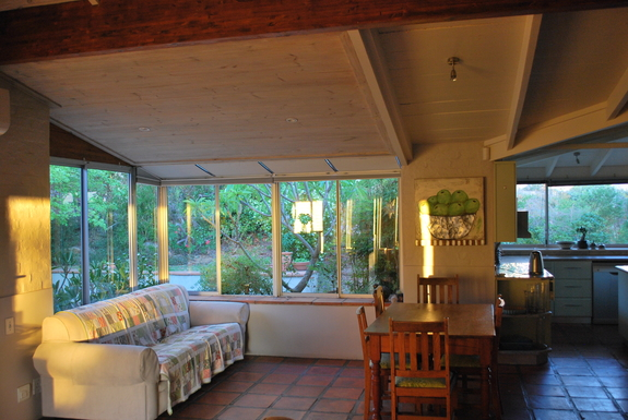 """BoligBytte til,South Africa,Somerset West,""""sunroom"""" left, small dining table, kitchen right"""