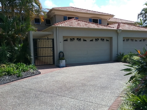 Home exchange in,Australia,RUNAWAY BAY,The driveway, garage and entrance to our home