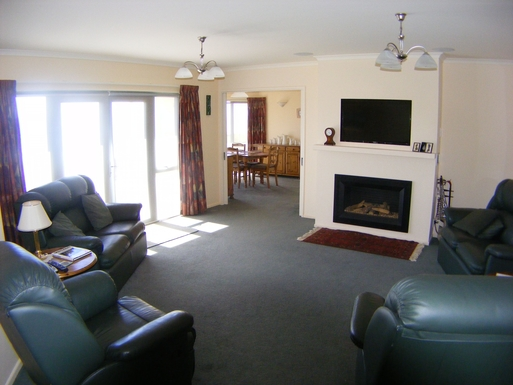 BoligBytte til,New Zealand,Nelson,Lounge with gas fire & air con.