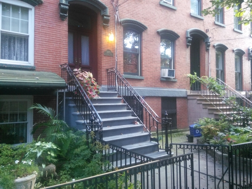 Front steps on quiet tree-linedresidential street,