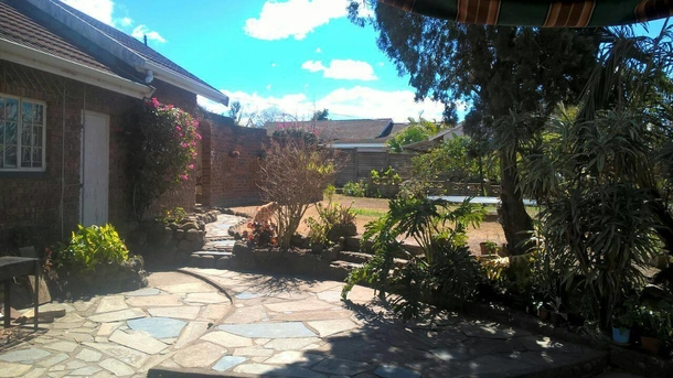 BoligBytte til,South Africa,Pietermaritzburg,View of garden and BBQ area from the lounge