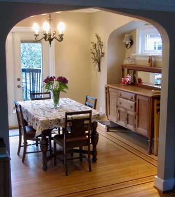 Home exchange in,Canada,Vancouver,Dining room with French doors to BBQ on back porch