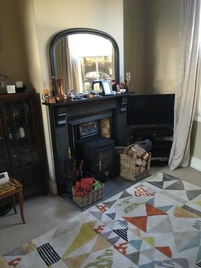 BoligBytte til,United Kingdom,York,Sitting room with original tiled fireplace