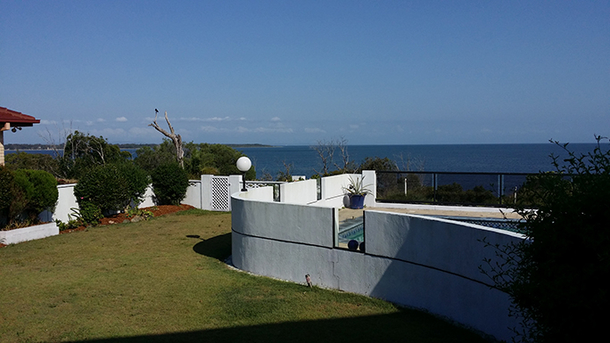 Home exchange in,Australia,SANDSTONE POINT,Garden & Swimming Pool view taken from the deck
