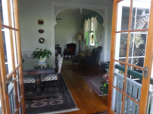 Home exchange in,Australia,WINDSOR,View from deck thr dining room to formal lounge