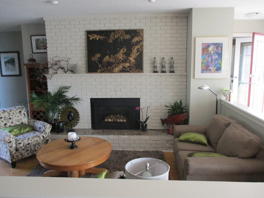 Sunken living room with gas fireplace