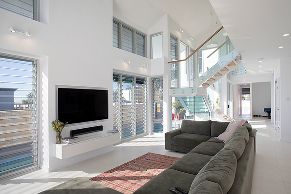 Home exchange in,Australia,Townsville,Living Room and internal stairs