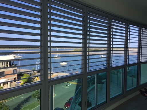 Home exchange in,Australia,Labrador,Balcony view with shutters open (My photo)