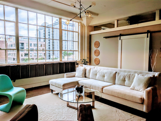 Home exchange in,United States,Portland,View of living room with barn door to office