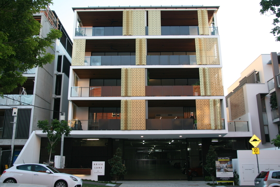 Home exchange in,Australia,Teneriffe,Our building features moving shade screens.