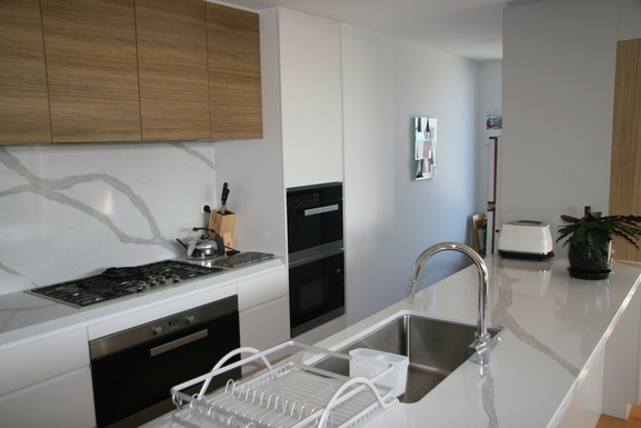 Home exchange in,Australia,Teneriffe,Kitchen off lounge/dining.