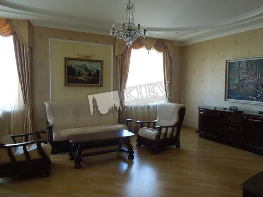 Home exchange in,Ukraine,Kiev,Living room with fireplace