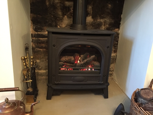 Home exchange in,United Kingdom,Halifax,The old fireplace has a gas stove for instant heat