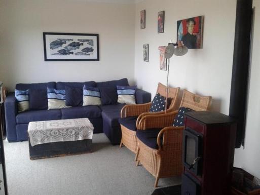 Home exchange in,Australia,ULLADULLA,Lounge room with wood heater