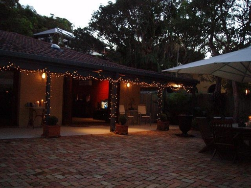 Home exchange in,Australia,BYRON BAY,The courtyard at night through to the house