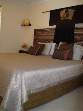 Home exchange in,Australia,BYRON BAY,King bed in bedroom 1