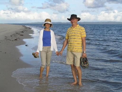 Home exchange in,Australia,SANDSTONE POINT,Marc and Serina walking on red beach-Bribie Island