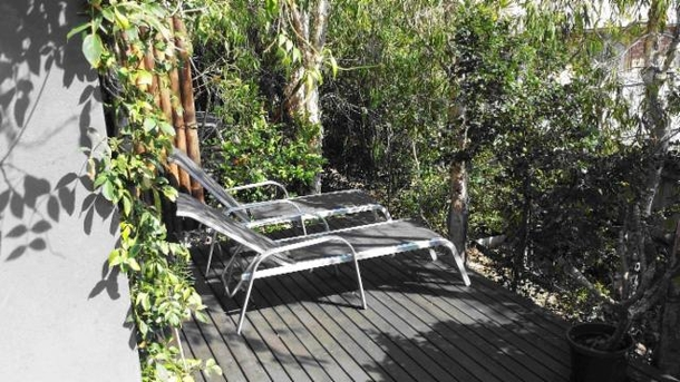 Home exchange in,Australia,POTTSVILLE,Pottsville relaxing deck under the native Ti Trees